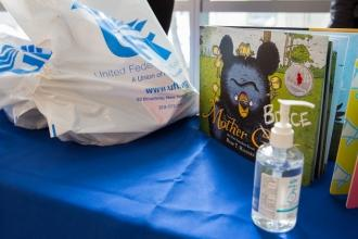 Hand sanitizer, a UFT plastic bag and books on display.