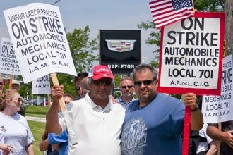 Men holding strike signs