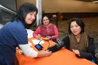 UFT member getting blood pressure reading