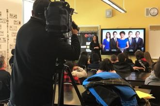 Camera operator filming in classroom