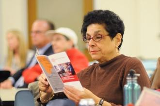 Older woman reading UFT Welfare Fund health benefits brochure