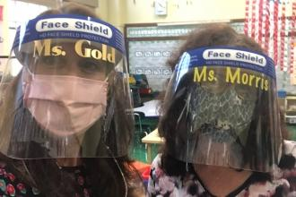 Teachers show off their masks and face shields