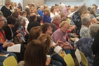 The refurbished Florida Retiree Center in Boca Raton was packed on March 7 to hear from Jill Biden (inset), the wife of Democratic presidential candidate Joe Biden.