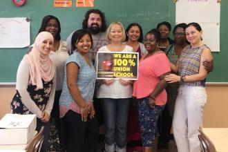 Group of UFT members in a classroom