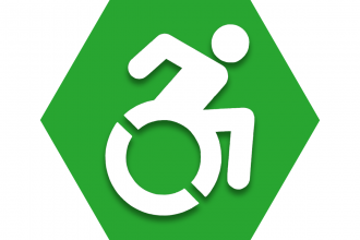 Hexagon with green background and symbol of person in wheelchair to represent UFT Capably Disabled Committee