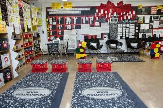 Classroom with two composition book rugs