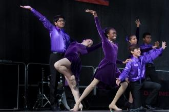 Student dancers wearing purple finish on stage