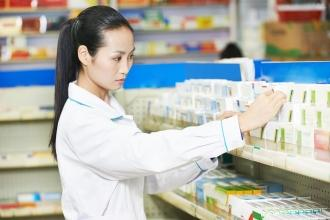 Asian women looking through prescriptions at a pharmacy
