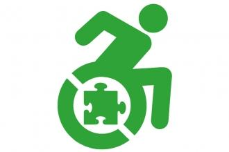 Green figure of a person with a wheelchair and a puzzle piece in the wheel
