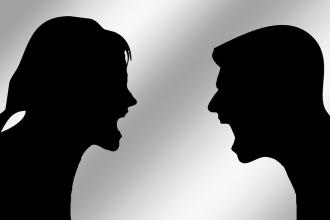Silhouette of two shouting people - generic