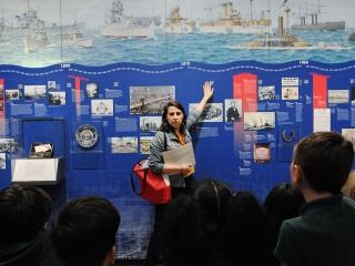 Museum educator Rebecca Saltzman and students discuss historical developments at