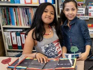 Third-graders Chloe and Giselle demonstrate their bascule bridge (also known as