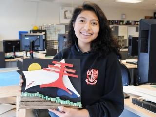A student holds a Japanese-inspired facade she created in class.