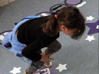 Frog leaps help a student gain awareness of her body in space. • Wall pushups in