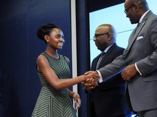 Scholarship winner Kaitlyn Yawson is greeted by UFT Vice President Sterling Robe