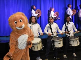 The PS/IS 184 mascot keeps the beat for the school's drum line.