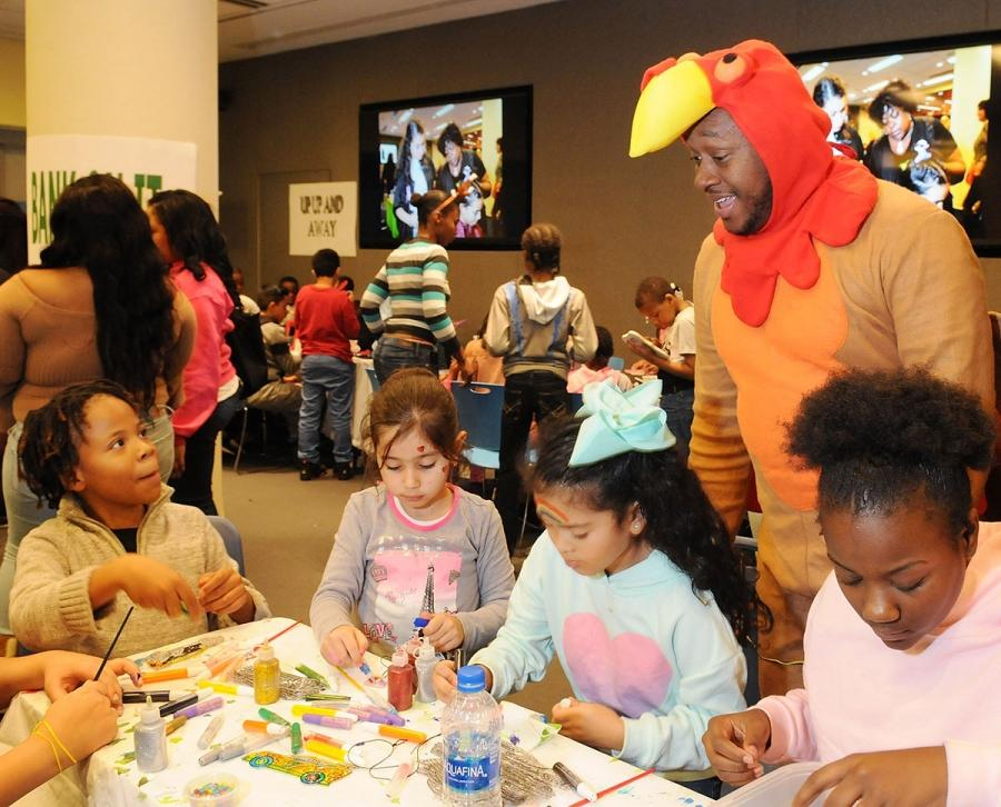Chapter Advocate Rashad Brown dons a turkey costume to the delight of children d