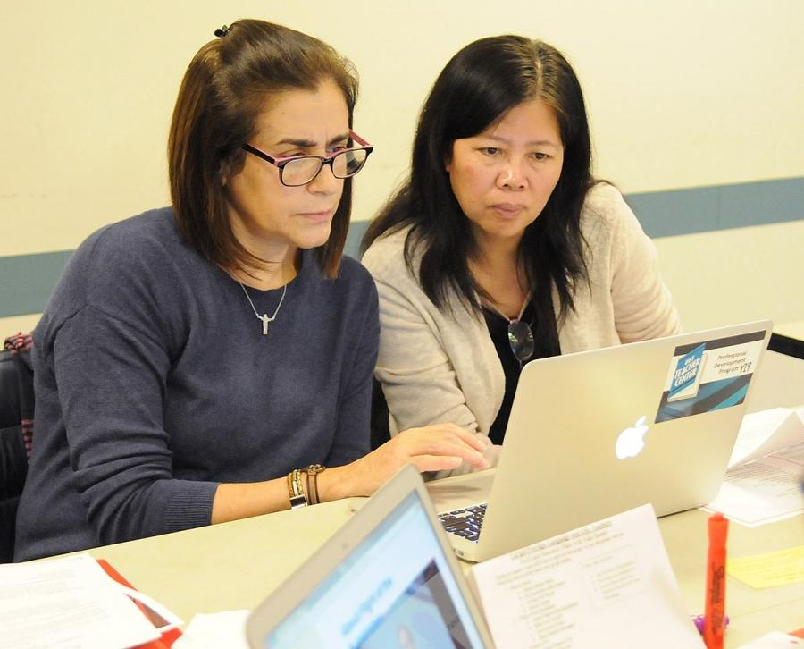 Paraprofessionals Suely Souto Maior (left) and Qi Dan Lei, from PS 503 in Brookl