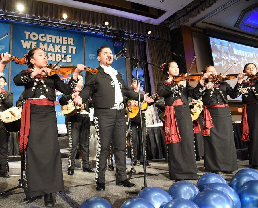 Schools Chancellor Richard Carranza serenades the luncheon attendees.