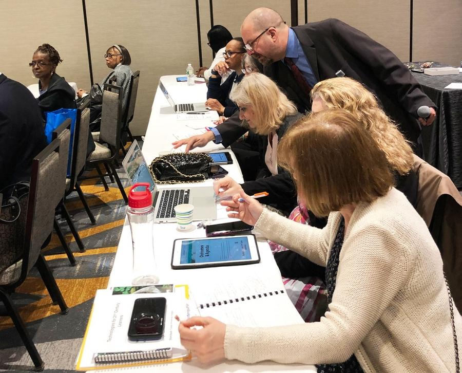 Educators get hands-on learning in the workshop on instructional technology.
