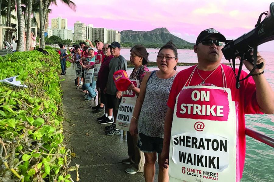 Striking hotel workers, who are members of UNITE HERE, picket on Oct. 18 on the