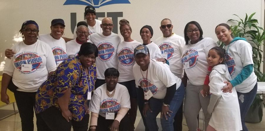 Some members of the UFT Bronx parent conference planning committee smiles for the camera after a successful event.