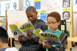 Students read their new books.