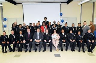 Proud honorees with NYPD officials and event organizer Perez-Gonzalez (front row