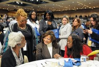 Harlem Assemblywoman Inez Dickens (seated, center) talks to Lobby Day participan