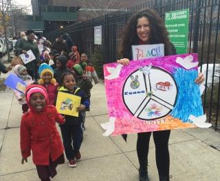 Teacher Katia Cox marches around PS 208 with her pre-K students.