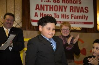 Third-grader Anthony Rivas receives a standing ovation at PS 88 in Ridgewood on