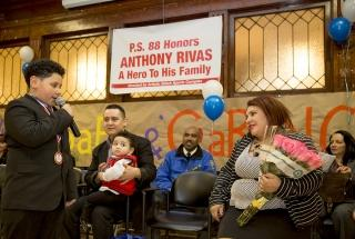 Anthony addresses his mom at the ceremony while his father, Cleber Rivas, and ba