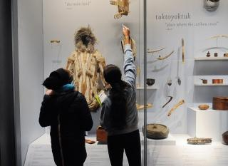 Eighth-graders at MS 447 study Native artifacts at the Museum of the American Indian.