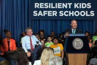 UFT President Michael Mulgrew speaks about the agreement while Mayor Bill de Blasio looks on.