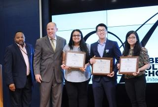 Standing with graduate winners (from third left) Sarah Labib, Yinchun Pan and Re
