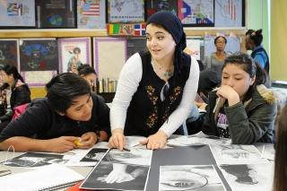 Gehan Habashy helps students create self-portraits overlaid with identity poems