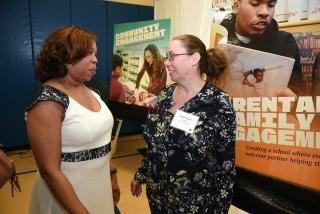 UFT Vice President for Elementary Schools Karen Alford (left) chats with teacher