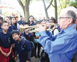 Docent Ed Polcer, a cornet player who has performed at the White House and the r