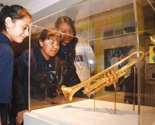 Students check out one of the trumpets owned by the jazz great, minutes after th