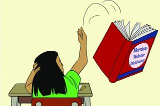 Girl sitting at a desk tossing a dictionary