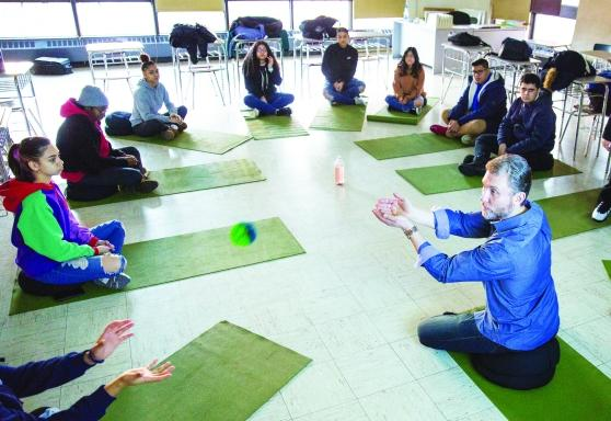 Students practicing mindfulness on yoga mats
