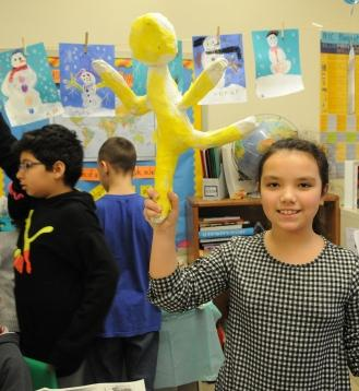 Students show off their puppets